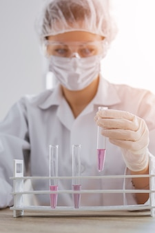 Scientis with test tube making research in clinical laboratory