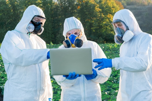 Scientist and agronomists wearing a white protective equipment