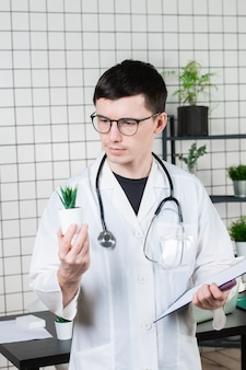 Scientist conducts experiments with a green plant