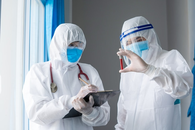 Scientist hold tube with blood test with the virus name coronavirus,vaccine,new epidemic coronavirus,coronavirus disease 2019 (covid-19),coronavirus has turned into a global emergency.