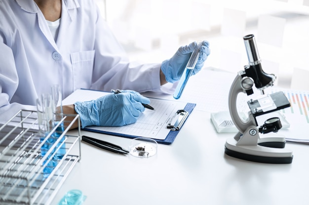 Scientist in lab coat working in biotechnological laboratory