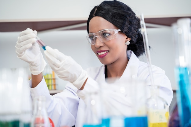 Scientist  in laboratory with holding a test tube. medical healthcare technology and pharmaceutical research and development concept