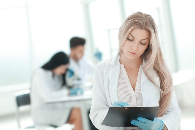 Scientist make notes to the clipboard in the clinical laboratory. photo with copy space