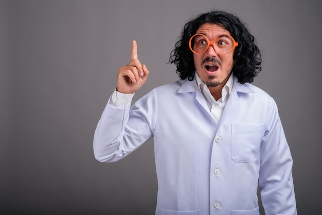Scientist man doctor with mustache wearing big eyeglasses