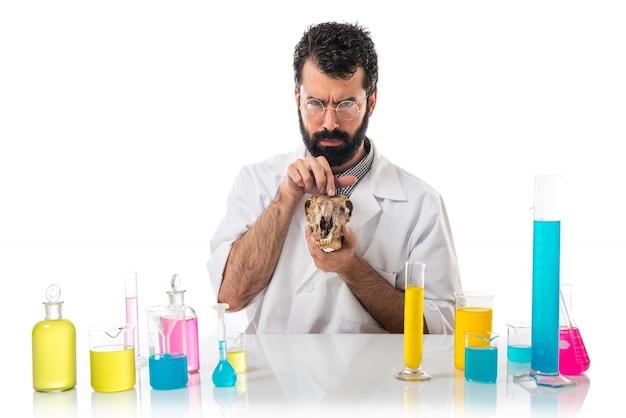 Scientist man holding a skull