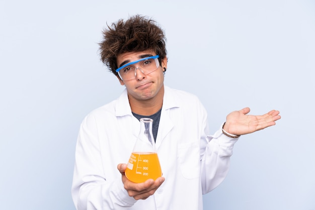 Scientist man over isolated blue wall