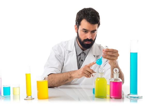 Scientist man with test tubes