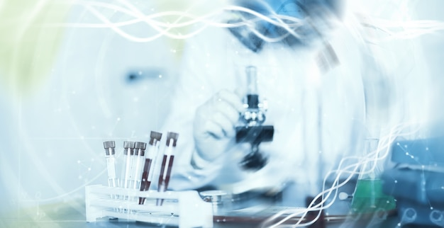 A scientist researcher in the laboratory is testing drugs for treatment of viral pneumonia. coronovirus blood test of infected patients. world pandemic.