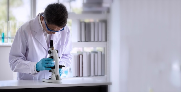 Scientist researching by microscopy technique in laboratory