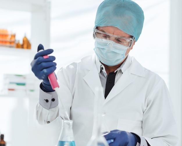 Scientist testing a liquid in a laboratory flask