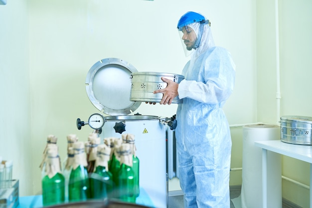 Scientist working with machines in laboratory