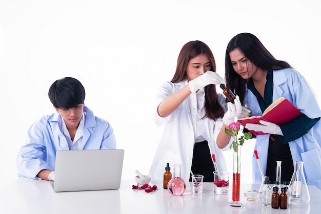 The scientists conducting experiments in laboratory