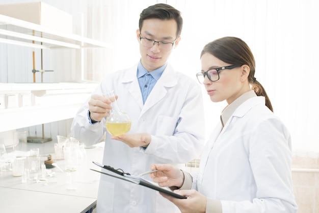 Scientists conducting research in laboratory