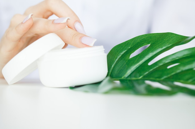 Scin care, scientist hands testing texture of beauty products