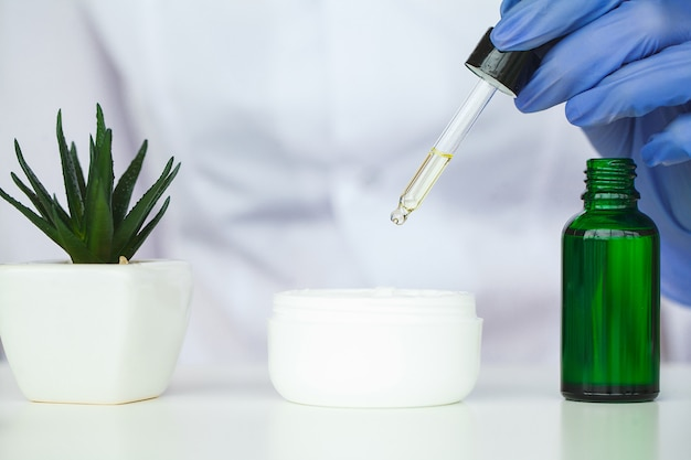 Scin care. scientist hands testing texture of beauty products