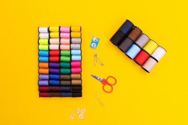 Scissors, buttons and pins isolated on a bright background
