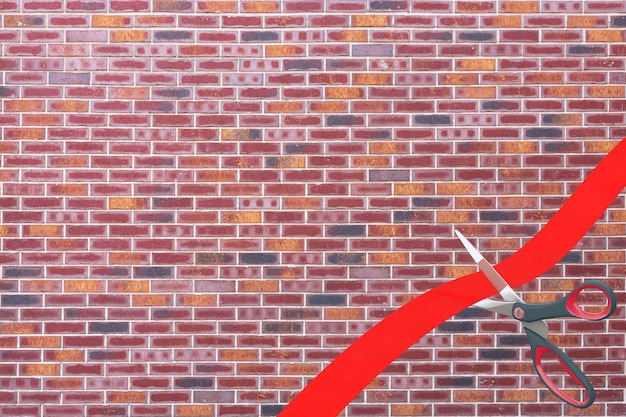 Scissors cutting red ribbon with blank space for your design in front of brick wall background. 3d rendering
