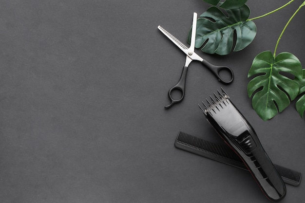 Scissors and hair trimmer copy space