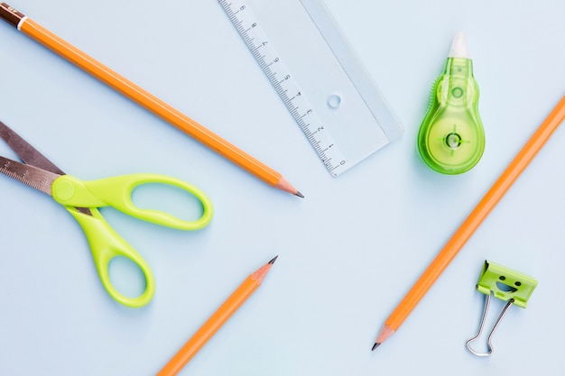 Scissors pens liner and smiley paper clip