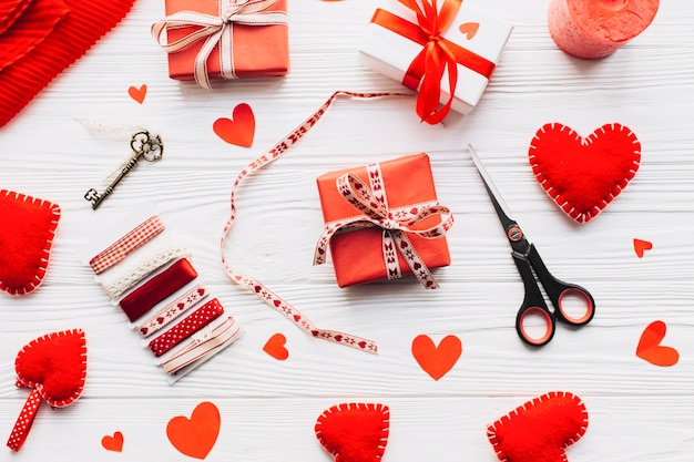 Scissors and ribbons near hearts and present