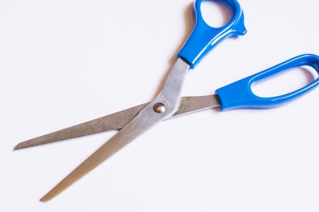 Scissors on white
