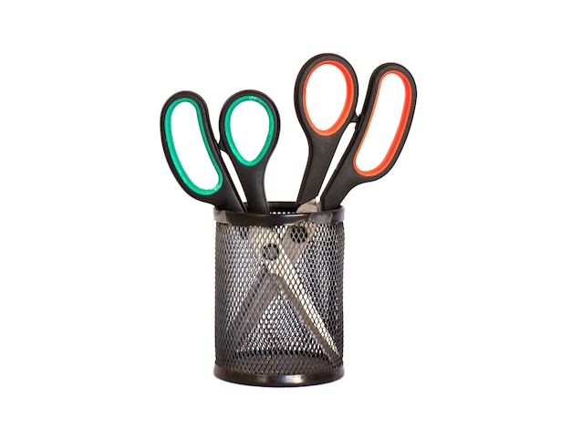 Scissors with a red and green handle in a black metal holder. is