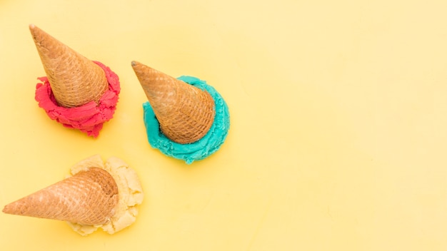 Scoop down bright fruit ice cream on yellow surface