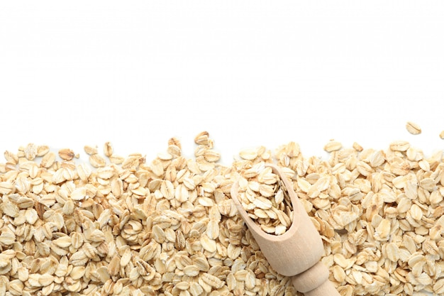 Scoop and oatmeal flakes frame isolated on white wall