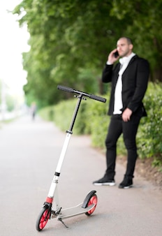 Scooter with businessman talking on the phone