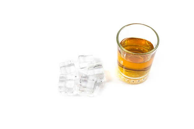 Scotch whiskey with ice in glass