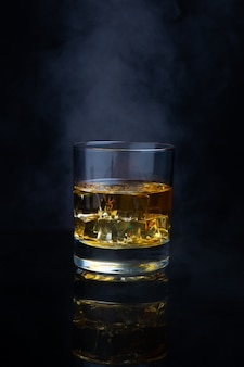 Scotch whiskey with ice and smoke