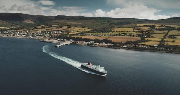 Scotland, brodick ferry terminus aerial shot of ship crossing, arran island