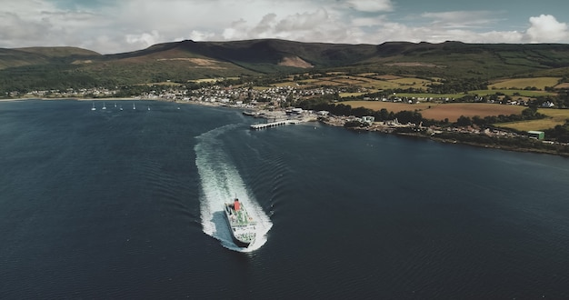 Scotland's ocean, passenger ferry aerial view in coastal water of firth-of-clyde gulf