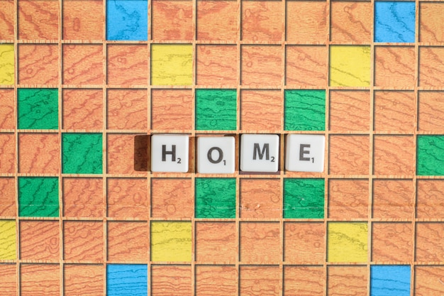 Scrabble game letters. word home on game board. flat lay top view.