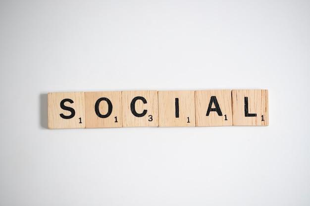 Scrabble letters spelling social, business concept