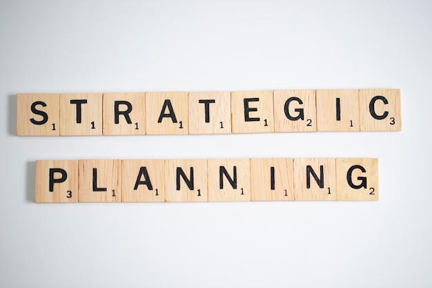 Scrabble letters spelling strategic planning, business concept