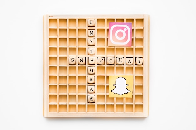 Scrabble wooden game showing instagram and snapchat words with their icons