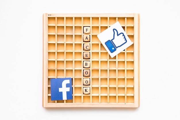 Scrabble wooden game with like symbol, facebook word and icon
