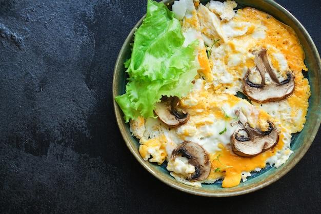 Scramble fried eggs omelet mushroom
