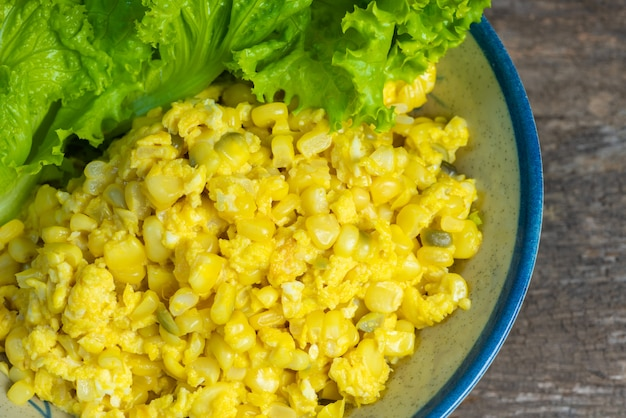 Scrambled eggs rustic style with sweet corn