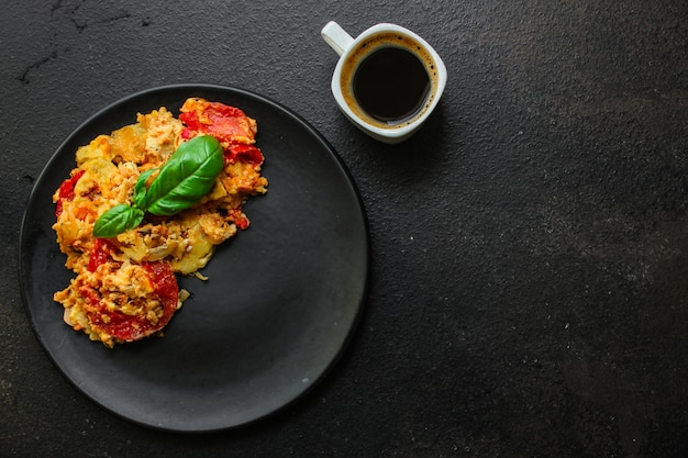 Scrambled eggs tomatoe, breakfast delicious and healthy, menu. food.  copyspace