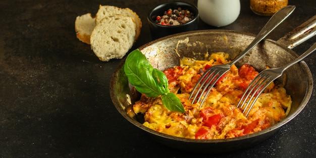 Scrambled eggs tomatoe, breakfast delicious and healthy, menu. food.  copyspace