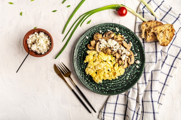 Scrambled eggs with mushrooms and cottage cheese