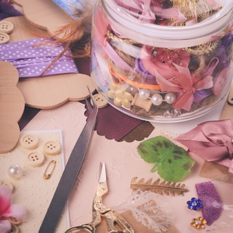 Scrapbooking craft materials in a glass bottle