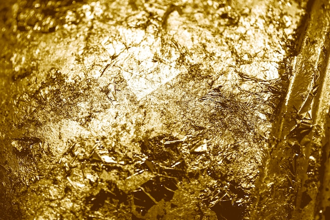 Scraps of gold foil textured background
