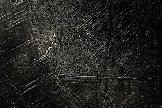 Scratched black paint from wooden texture
