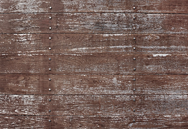 Scratched brown wooden textured flooring background