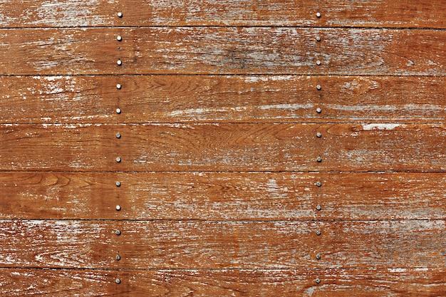 Fondo strutturato della pavimentazione di legno marrone graffiato