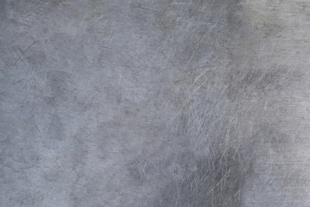 Scratched metal texture, brushed steel plate background