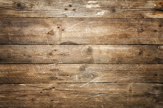 Scratched wooden texture, background with copy space.